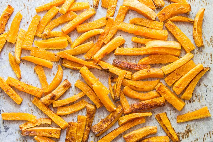 Butternut Squash Fries on a Parchment Lined Baking Sheet