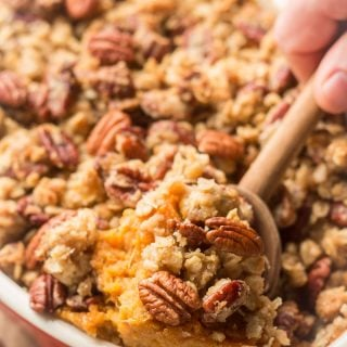 Wooden Spoon Scooping Sweet Potato Casserole From a Baking Dish