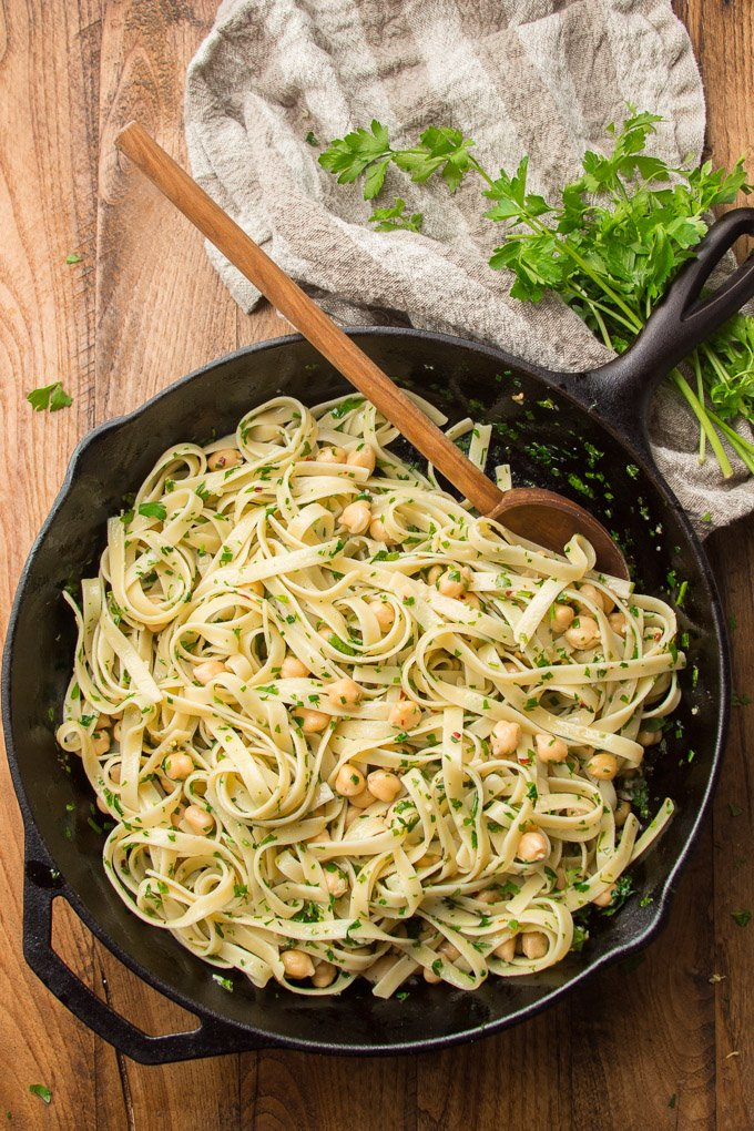 Skillet Filled with Garlic Butter & Herb Pasta with Chickpeas with Wooden Spoon