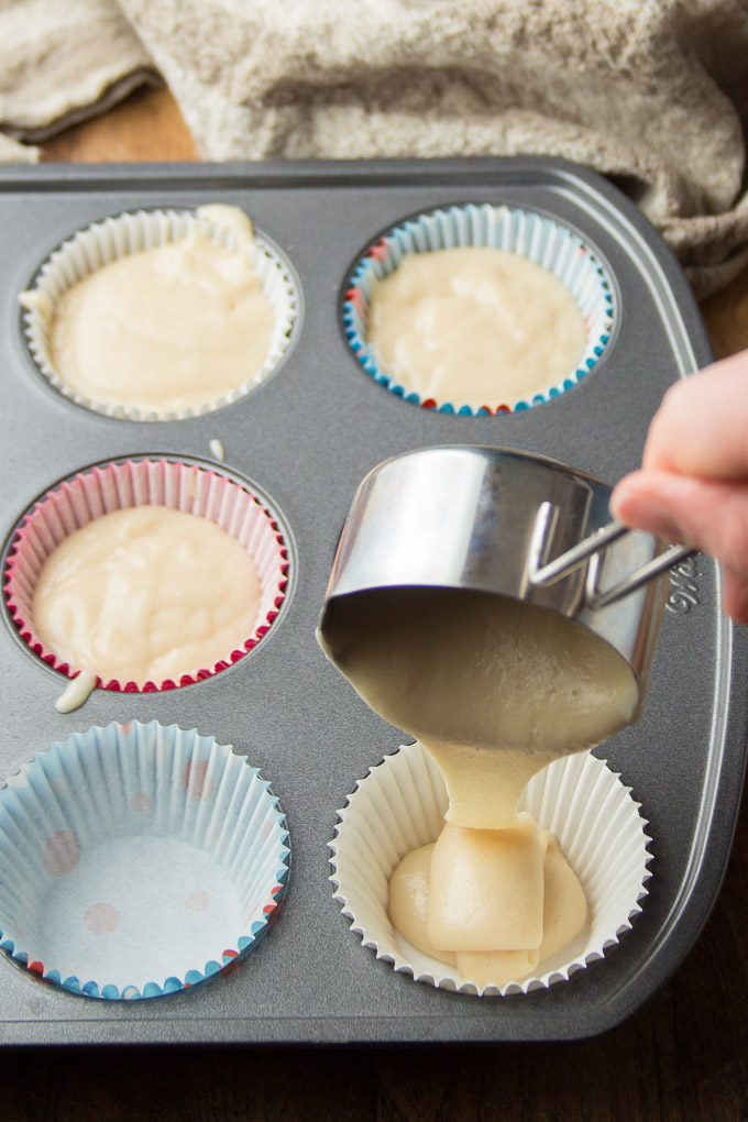 Vegan Vanilla Cupcake Batter Being Spooned into a Muffin Tin
