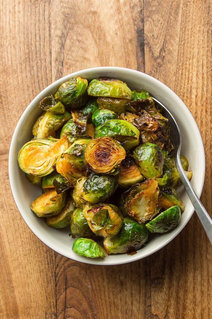 Bowl of Roasted Brussels Sprouts with Spoon