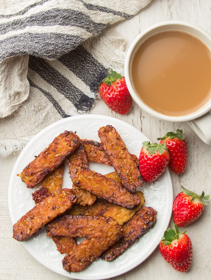 Plate of Tempeh Bacon with Strawberries and Cup of Coffee