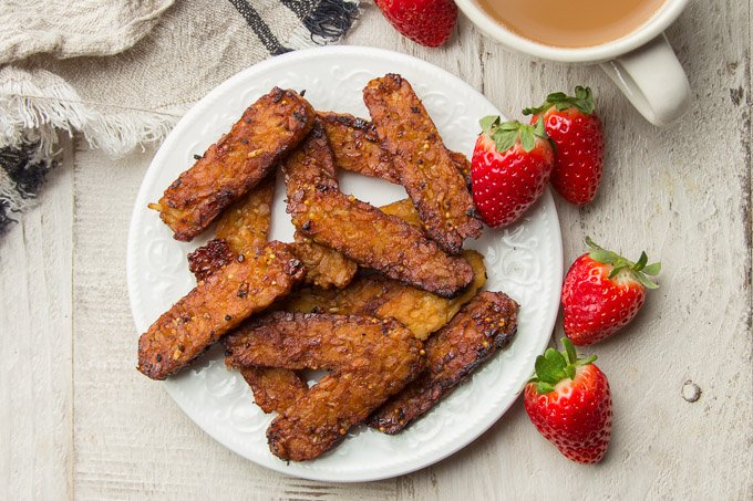 Tempeh Bacon on a Plate on a White Table with Strawberries