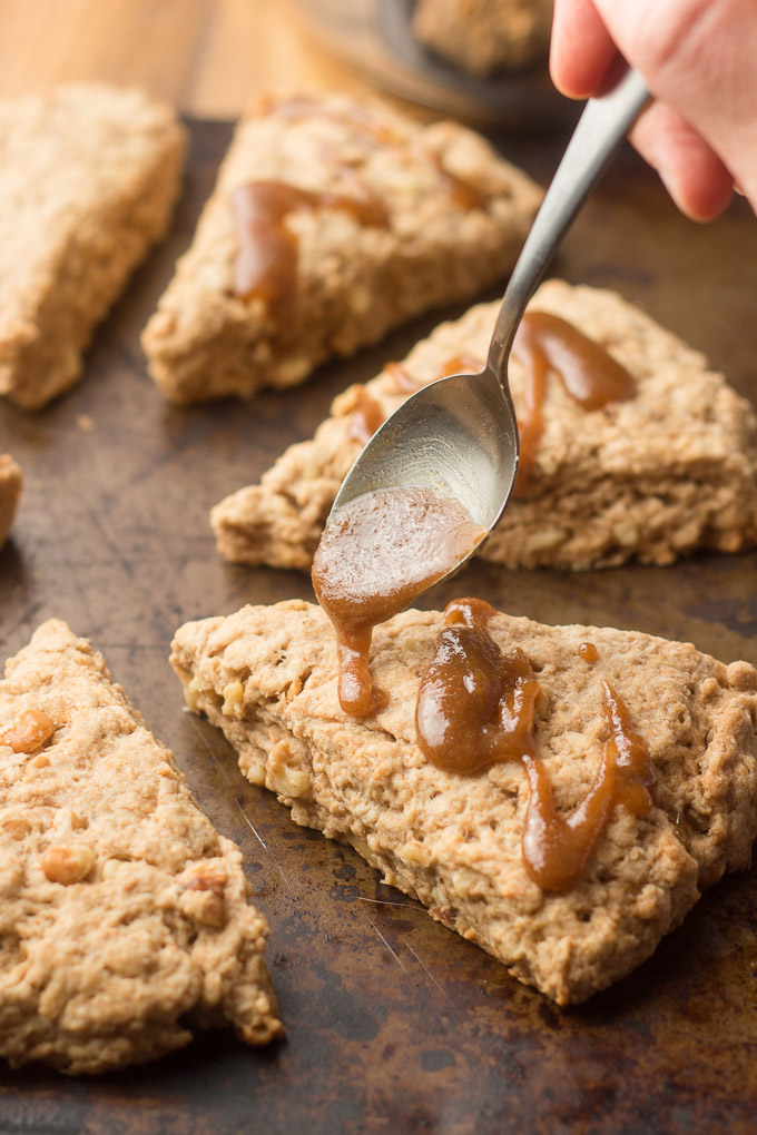 Spoon Drizzling Brown Sugar Glaze ona Vegan Scone