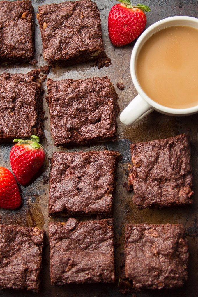 Vegan Brownies Arranged on a Baking Sheet with Coffee Cup and Strawberries
