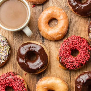 Vegan Doughnuts on a Wooden Surface with a Cup of Coffee