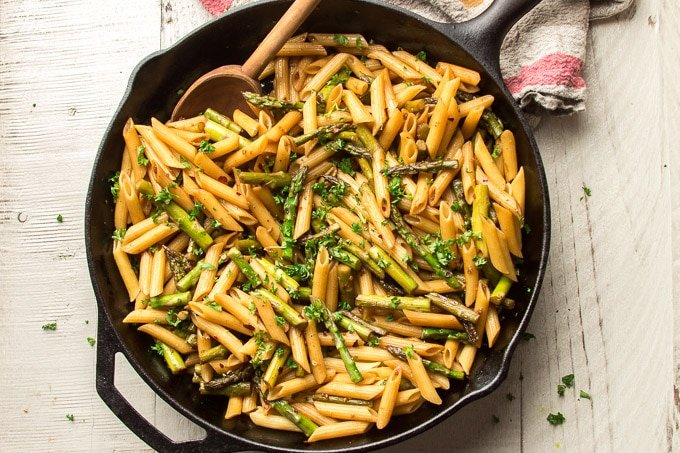 Skillet of Balsamic Asparagus Pasta on a White Table