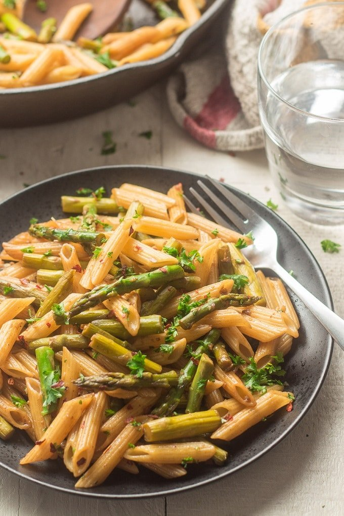 Plate of Balsamic Asparagus Pasta with Water Glass in the Background