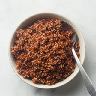 Bowl of Red Quinoa with a Spoon