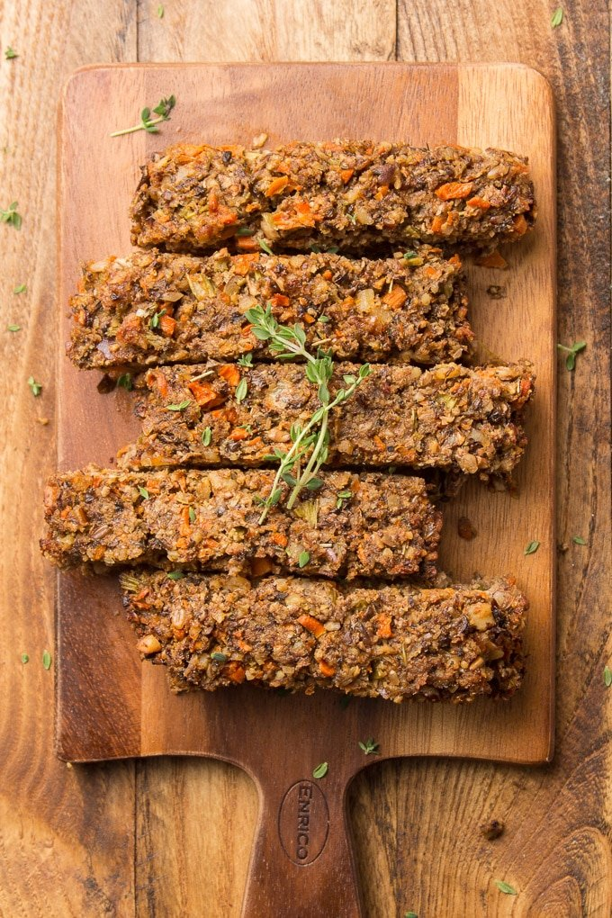 Sliced Nut Roast on a Cutting Board with Thyme Sprigs on Top