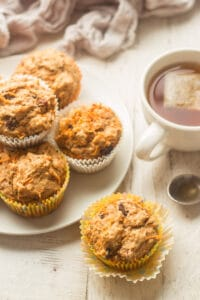 Vegan Carrot Muffins Arranged On a Table with a Cup of Tea