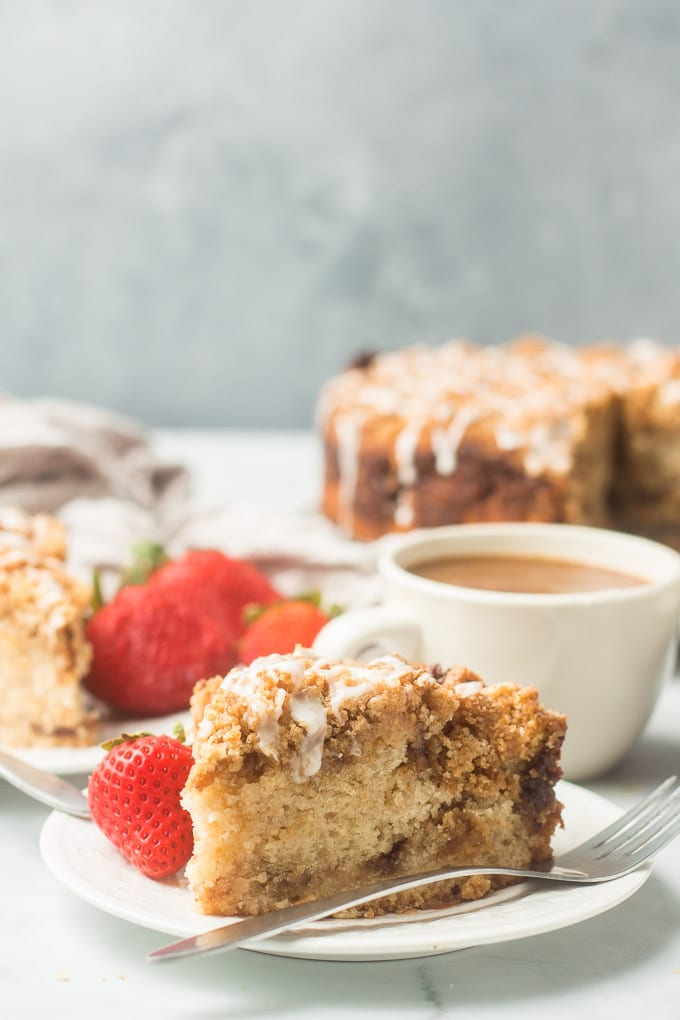 Table Set with Slices of Vegan Coffee Cake, Coffee, and Strawberries