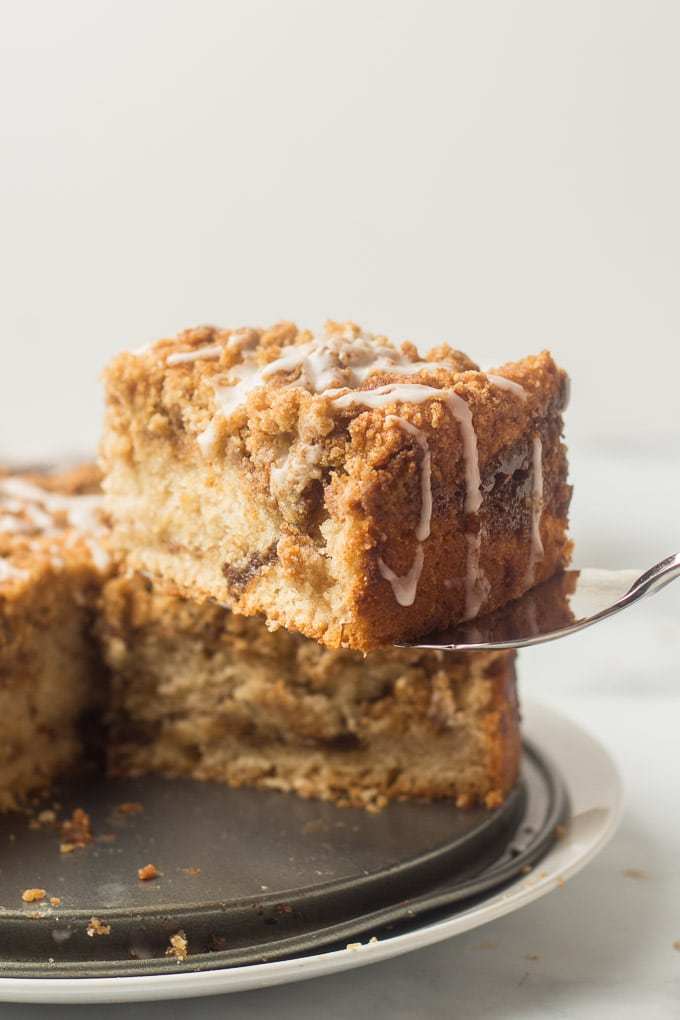 Cake Server Lifting a Slice of Vegan Coffee Cake from a Dish