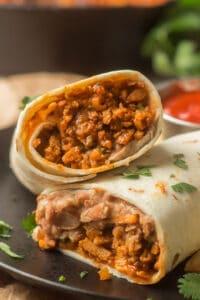 "Close Up of 2 Halves of a ""Beefy"" Vegan Burrito"