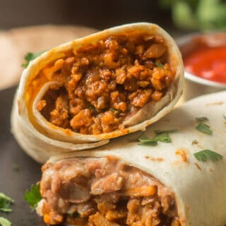 "Close Up of 2 Halves of a ""Beefy"" Vegan Burrito"
