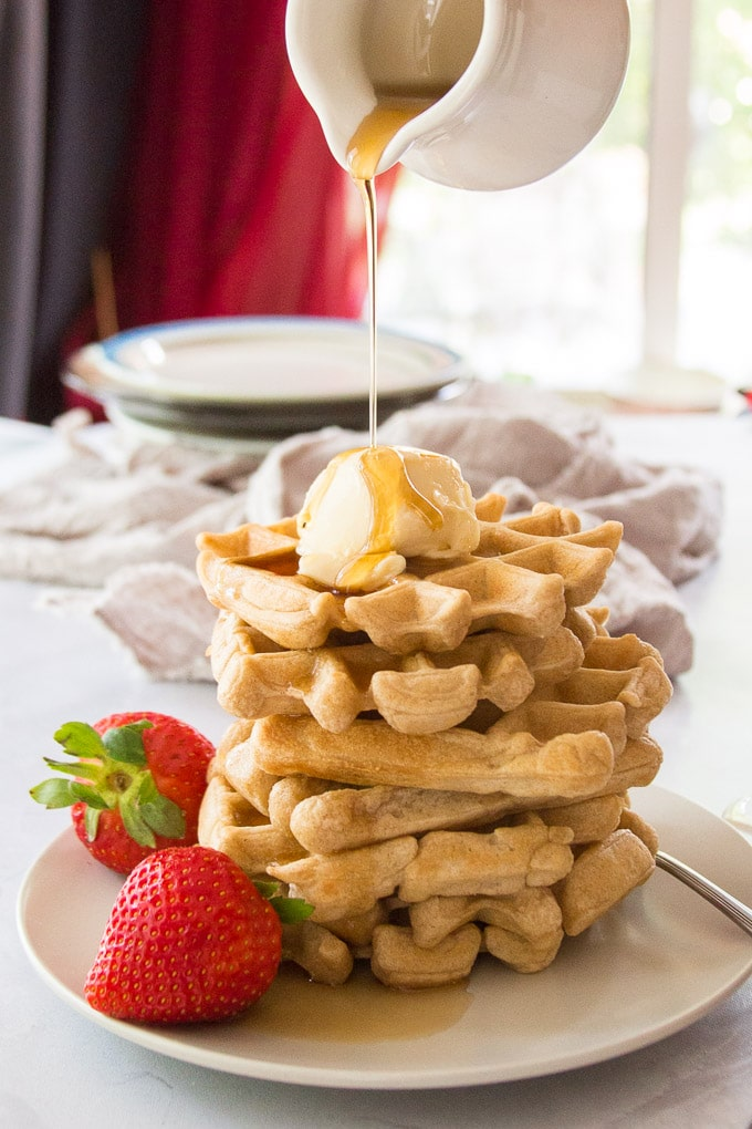 Syrup Being Poured over a Stack of Vegan Waffles