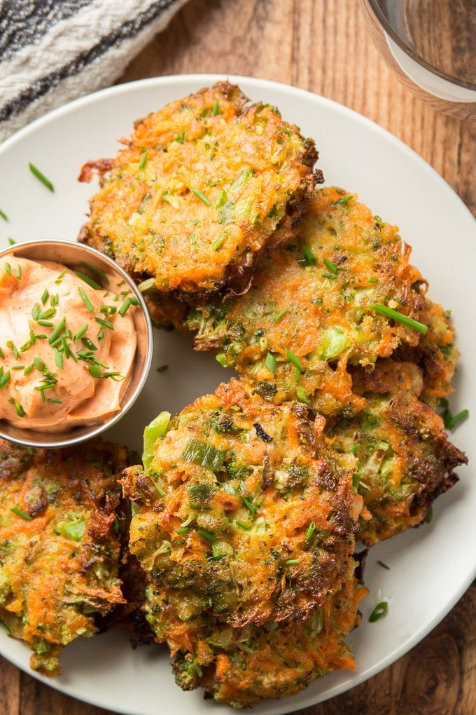 Close Up of Vegetable Fritters on a Plate with Chipotle Mayo on the Side
