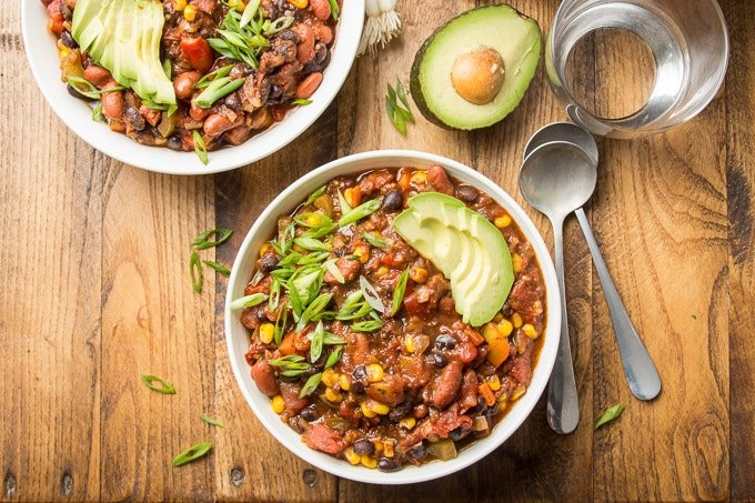 Two Bowls of Vegan Chili on a Wooden Surface