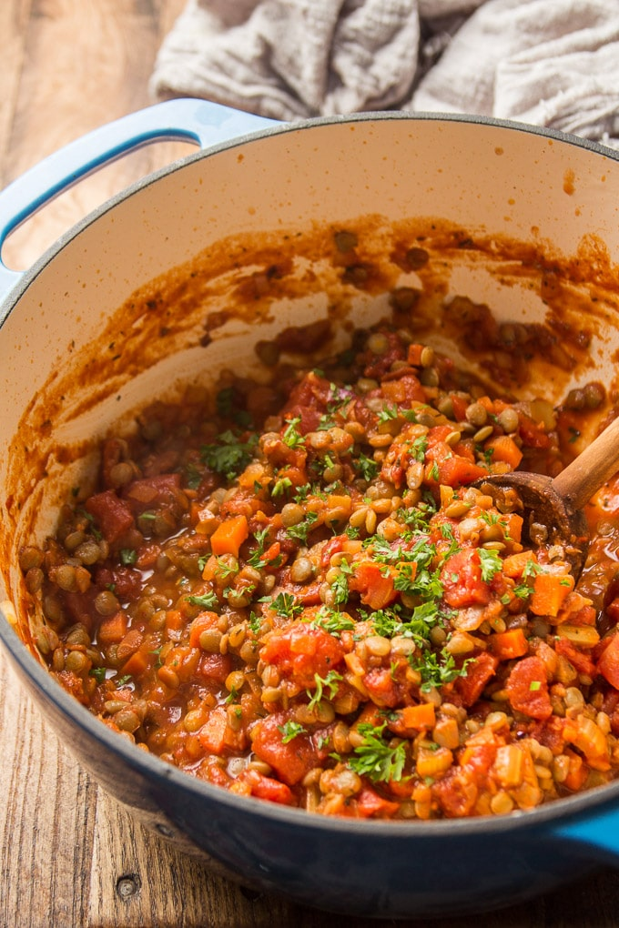 Lentil Bolognese in a Pot with Wood Spoon