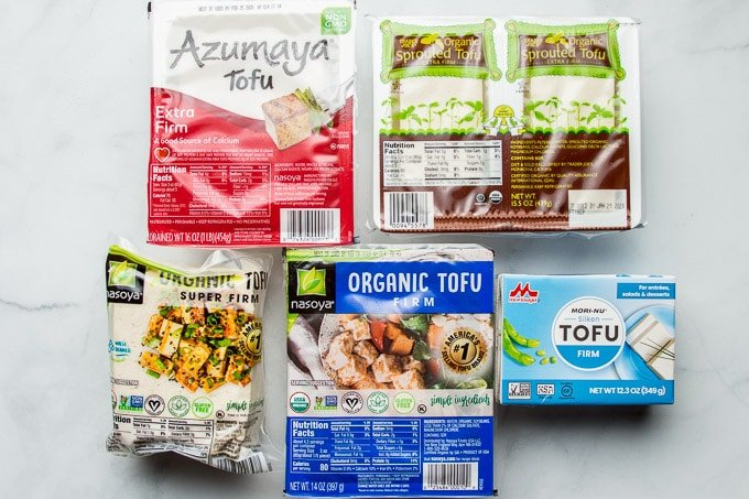 Tofu Packages on a Marble Backgroun