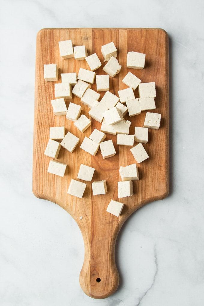 Diced Super Firm Tofu on a Cutting Board