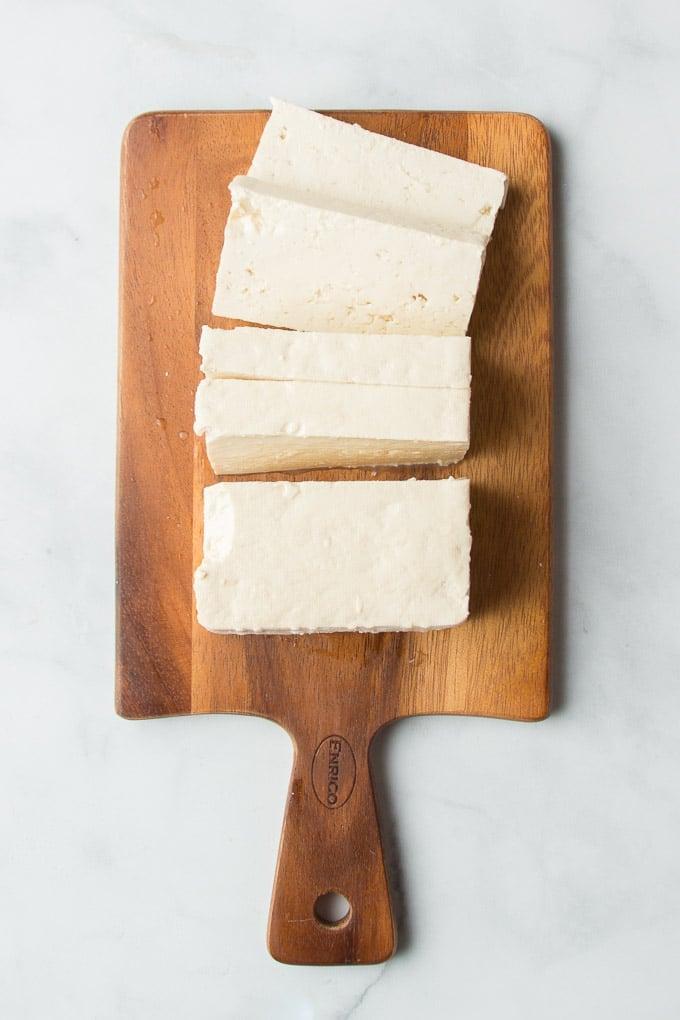 Sliced Block of Soft Tofu on a Cutting Board