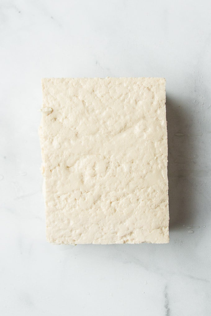 Block of Extra Firm Tofu on a Marble Background