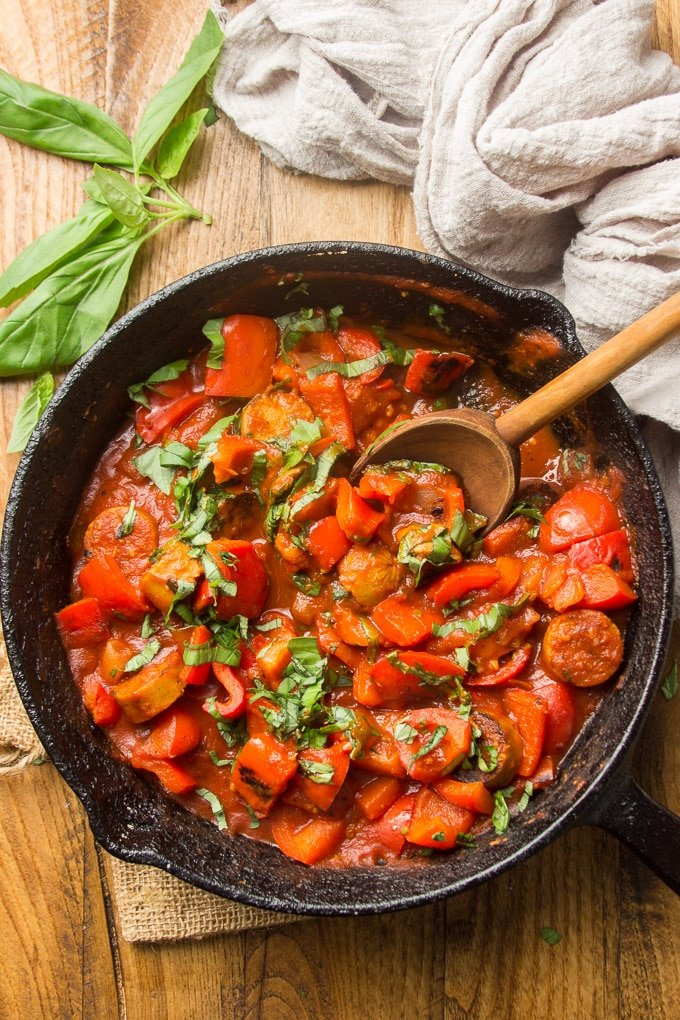 Vegan Sausage & Pepper Ragù in a Cast Iron Skillet with Serving Spoon