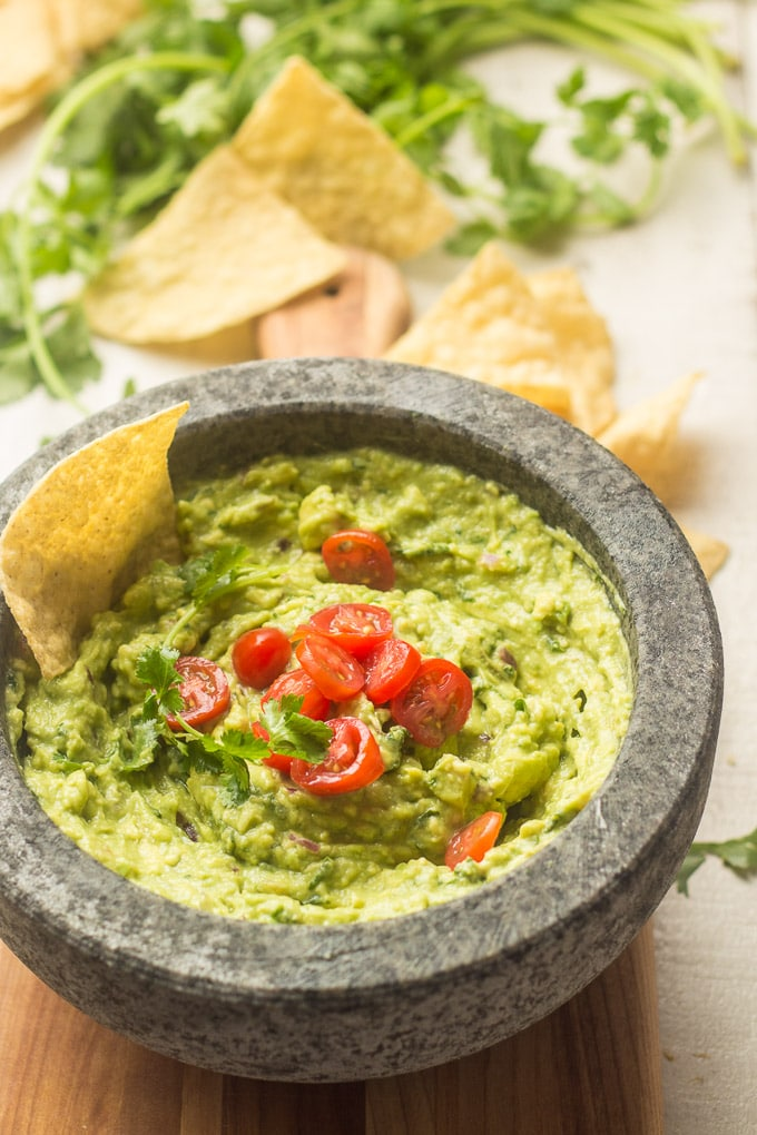 Guacamole in a Molcajete with Chips in the Background