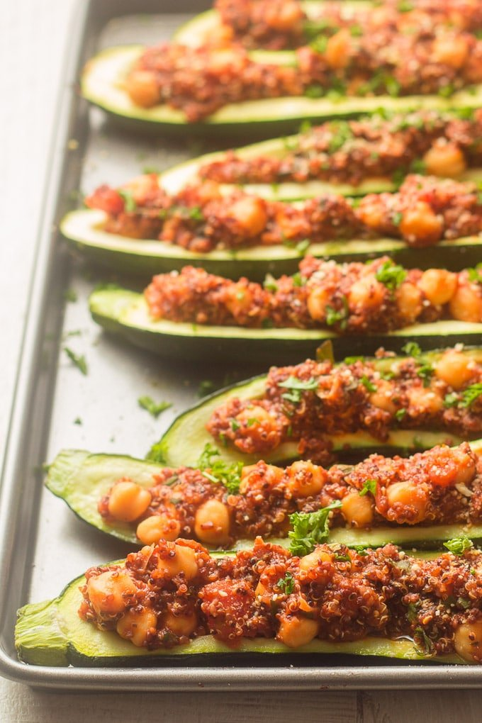 Side View of a Baking Sheet with an Array of Vegan Stuffed Zucchini Boats