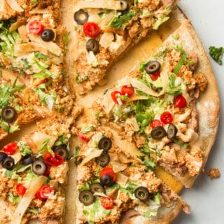 Sliced Vegan Taco Pizza on a Pizza Stone