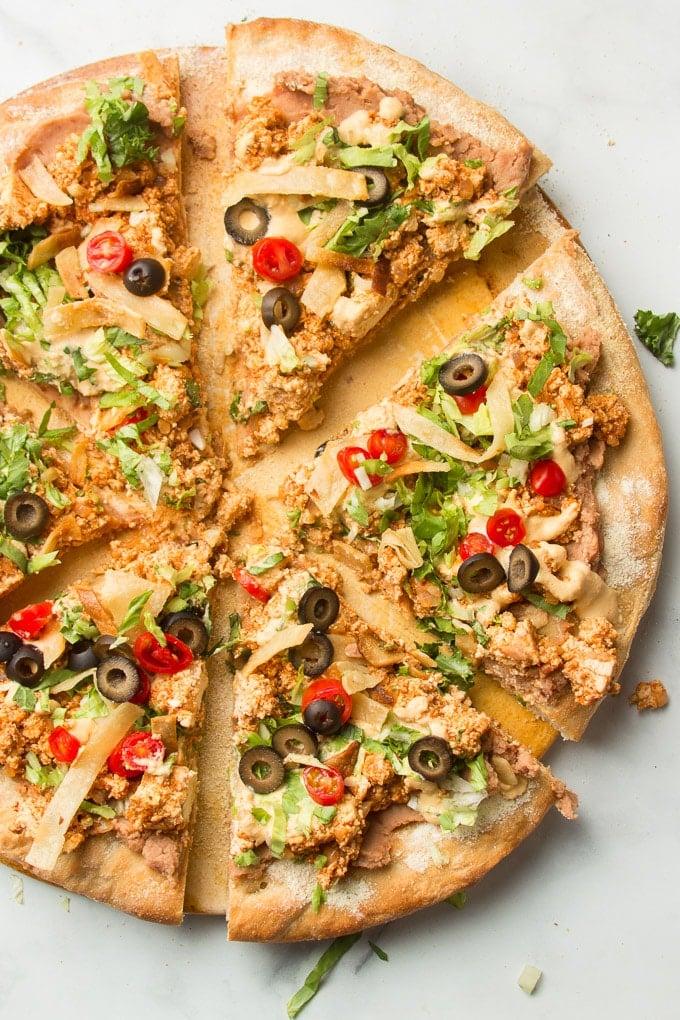 Sliced Vegan Taco Pizza on a Pizza Stone