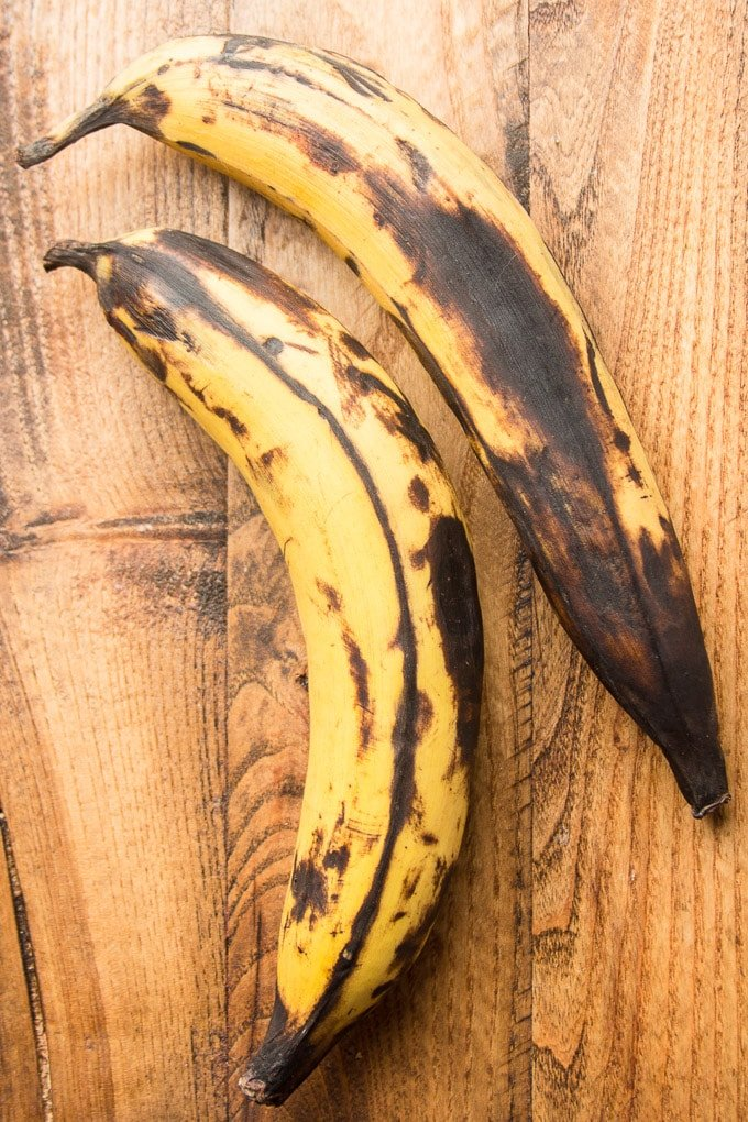 Two Ripe Plantains on a Wooden Surface