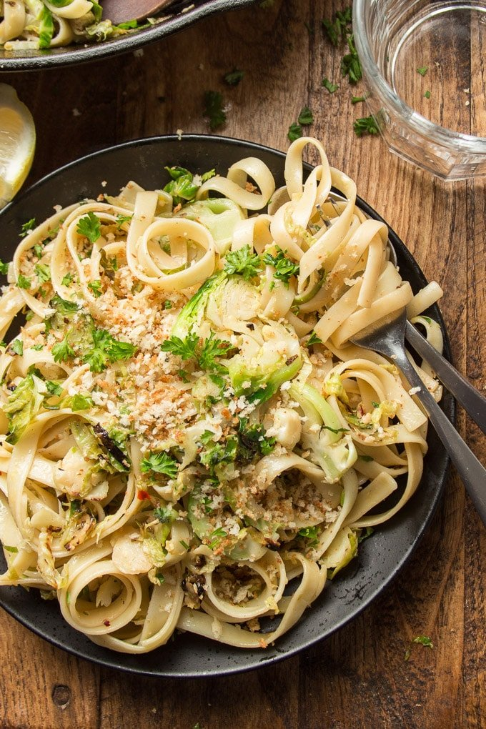 Close Up of a Plate of Brussels Sprout Pasta with Cluster of Pasta Wrapped Around a Fork
