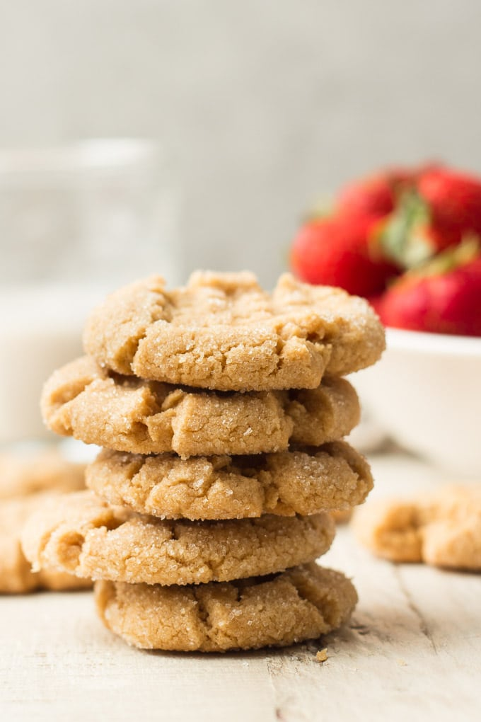 Stack of Vegan Peanut Butter Cookies with Bowl of Strawberries in the Background
