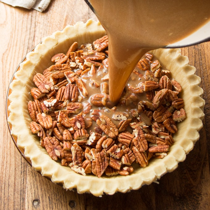 Vegan Pecan Pie Filling Being Poured into Crust