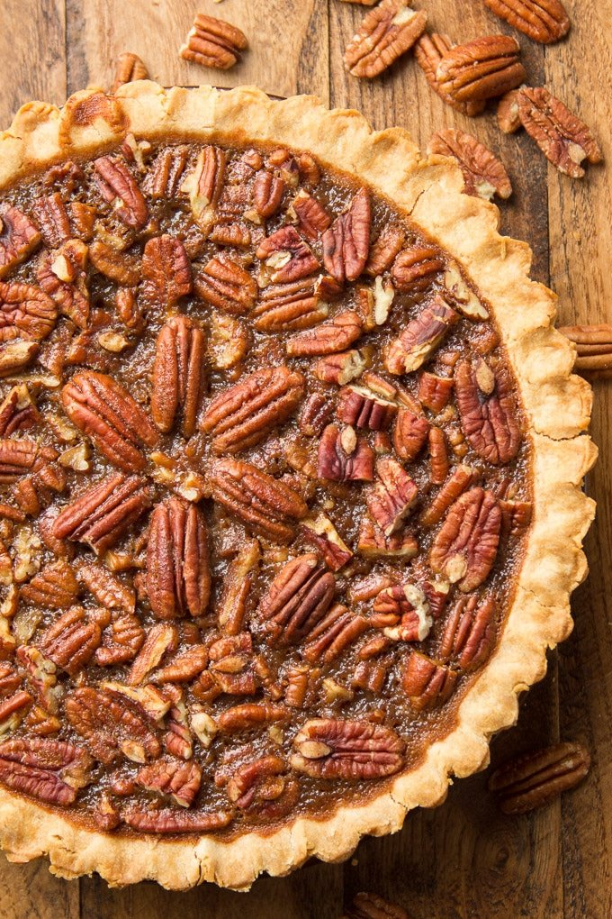 Close Up of a Whole Vegan Pecan Pie on a Wood Surface