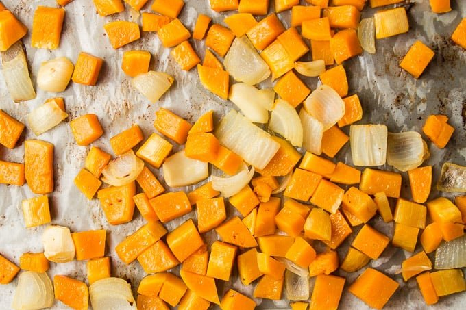 Roasted Butternut Squash, Garlic and Onions on Parchment Paper