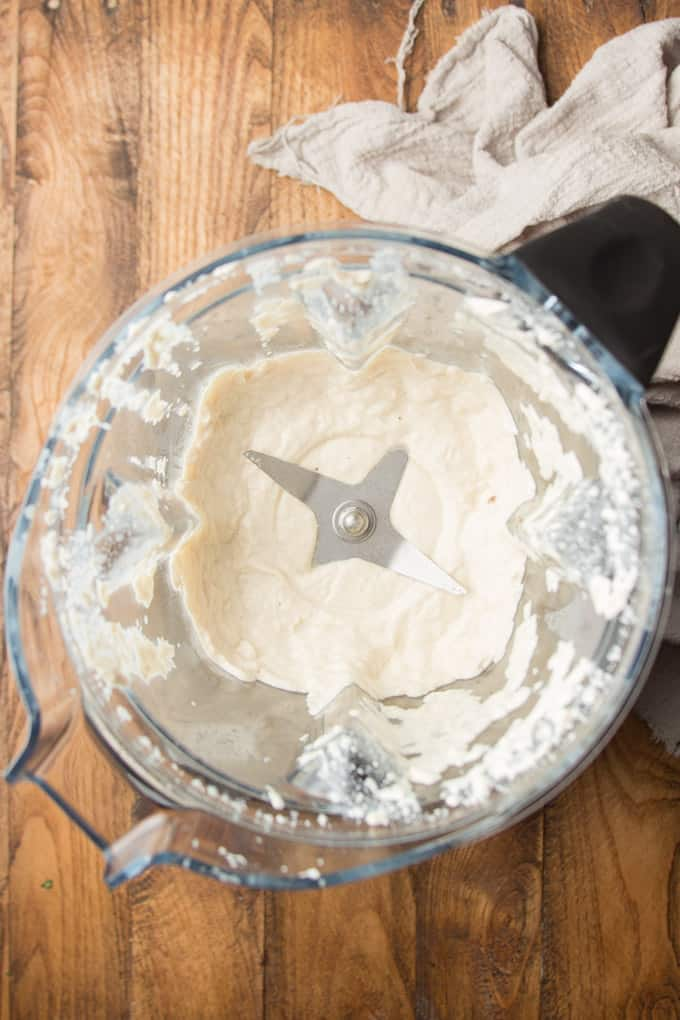 Cashew Cream in a Blender on a Wooden Surface
