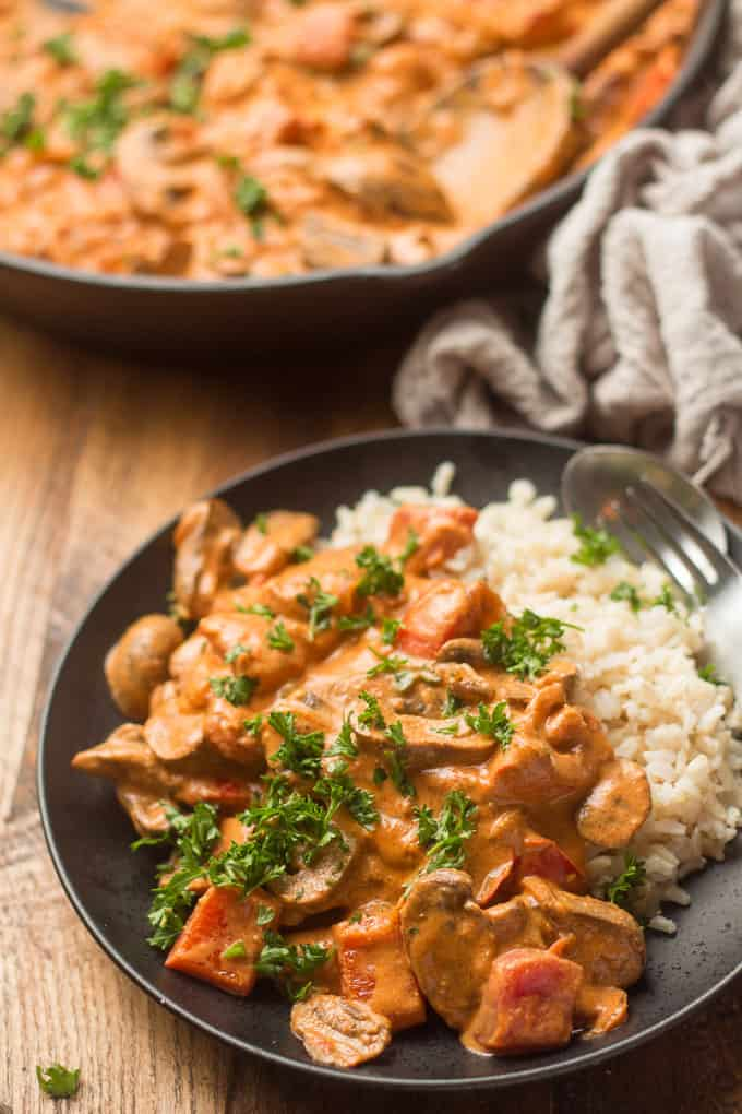Plate of Vegan Mushroom Paprikash and Rice with Skillet in the Background