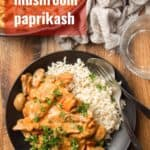 "Table Set with a Plate of Vegan Mushroom Paprikash and Rice with Text Overlay Reading ""Vegan Mushroom Paprikash"""