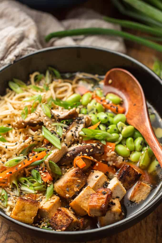 Close Up of a Bowl of Vegan Ramen with Wooden Spoon