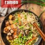 "Bowl of Vegan Ramen on a Wooden Surface with Text Overlay Reading ""Vegan Ramen"""