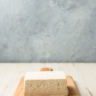 Block of Tofu on a Cutting Board