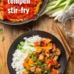 "Wooden Table Set with Skillet and Plate of Tempeh Stir-Fry with Text Overlay Reading ""Tempeh Stir-Fry"""