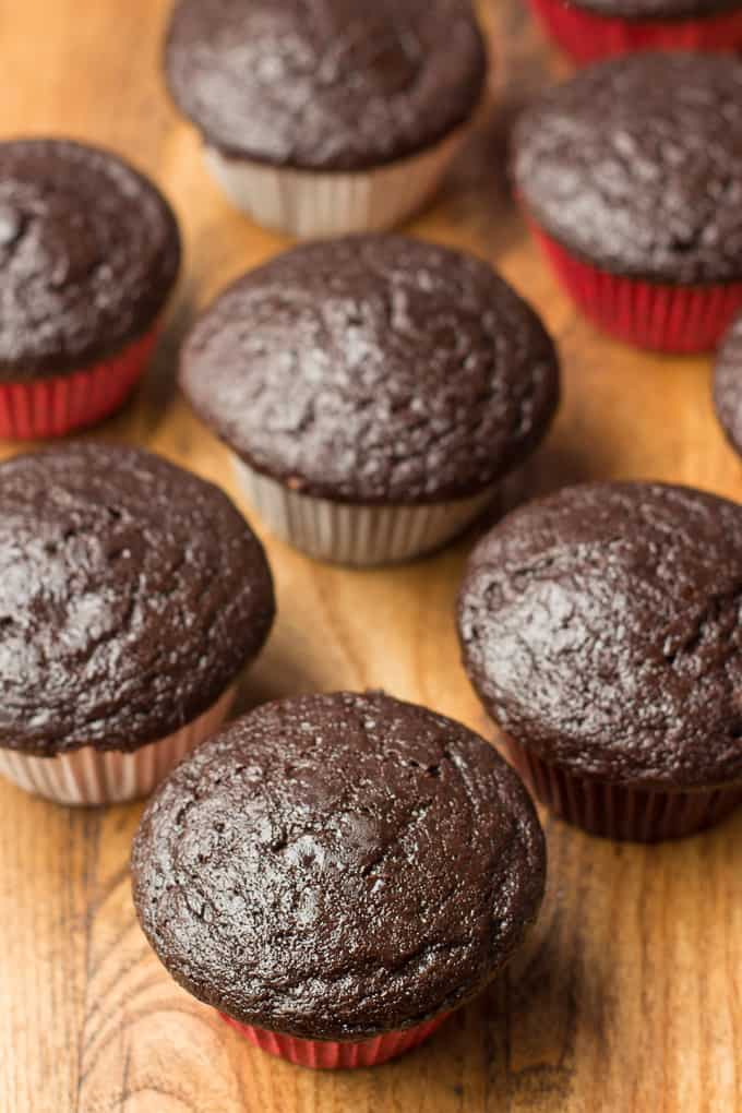 Unfrosted Vegan Chocolate Cupcakes on a Wooden Surface