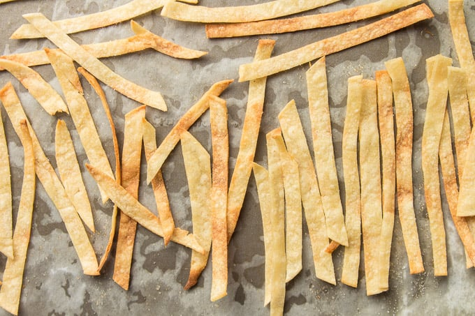 Baked Tortilla Strips on Parchment Paper