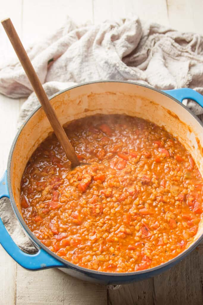 Pot of Red Lentil Chili with Wooden Spoon