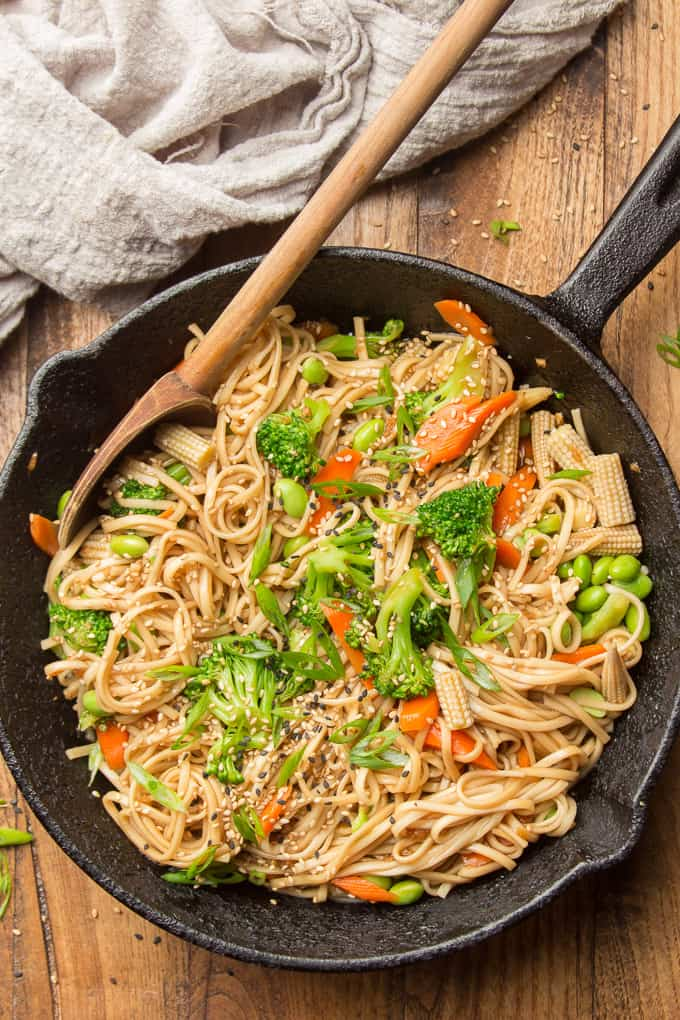 Wooden Surface Set with Skillet of Teriyaki Noodles with Wooden Spoon