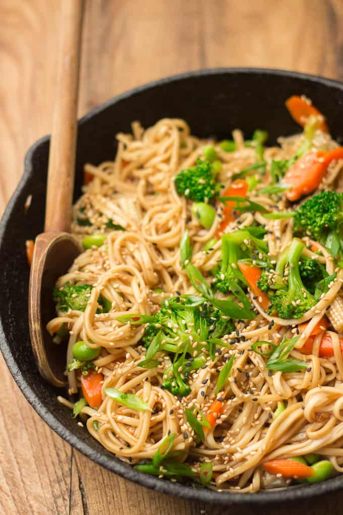 Close Up of Teriyaki Noodles in a Skillet with Wooden Spoon